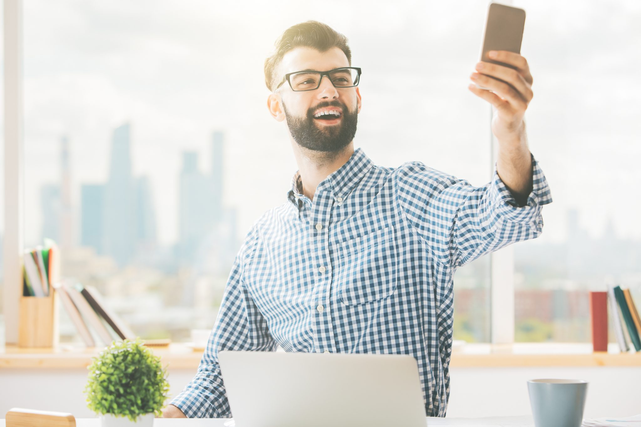 Casual male using cellphone